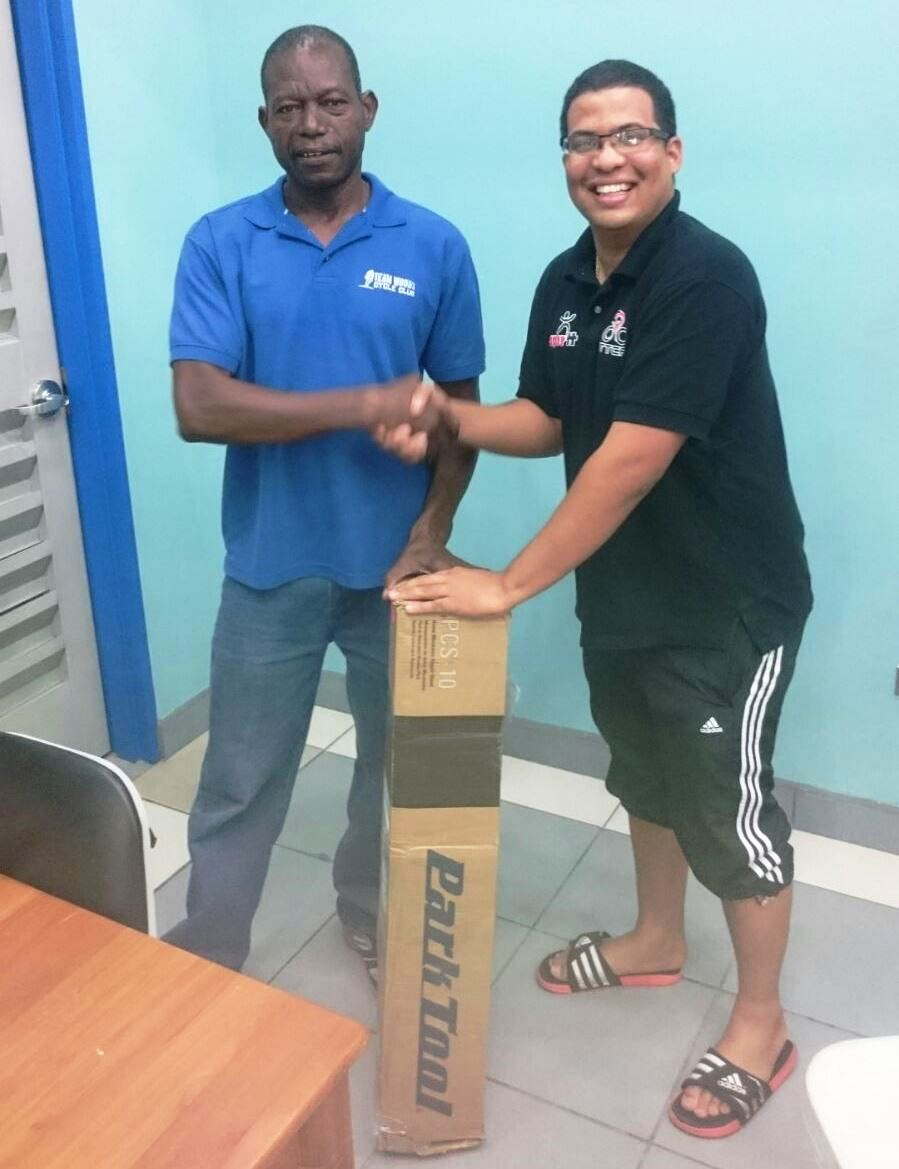 Rodney Woods receives his Bike Mechanic stand from TTCF Racing Secretary - Gary Acosta